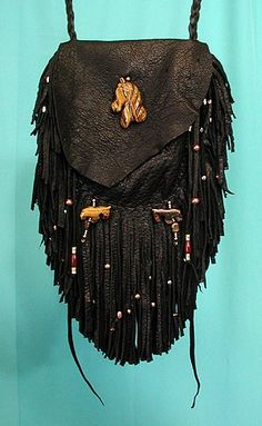 Large black deerskin medicine bag by Apache artist Cynthia Whitehawk. Horse totems carved from tiger eye stone.