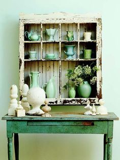Give an old window new life by turning it into a rustic cupboard. Construct a three-sided box to fit the window. Install shelves to align with the window muntins. Then attach the window to the front with flat hinges. Now you've created nooks to display pottery and other treasures.