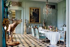 The north dining room is furnished with an 18th-century Italian chandelier, a Francis Barlow painting of a cassowary, and Louis XVI chairs.