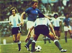 Argentina 1 Italy 1 in 1974 in Stuttgart. Romeo Benetti looks to go around Ramon Heredia in Group 4 at the World Cup Finals.