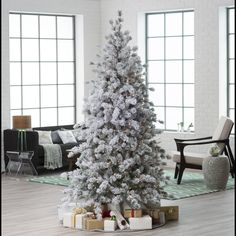 7.5 ft. Pre-lit Flocked Hard Needle Huntsville Pine Christmas Tree with Pinecones & Twigs by Sterling Tree Company | from hayneedle.com. Another one I would like to try instead of a green tree.