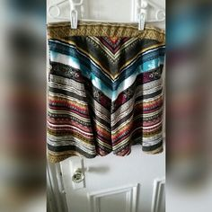 "Aztec print multicolored skirt NWOT! Aztec print multicolored skirt. 20"" long & 18"" waist.  95% polyester, 5 % spandex American Rag Skirts"