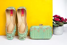 Vian Label's Iced Kiwi! A beautiful floral pattern in Cutdana on a sea-green pure raw silk base..Coordinated juttis and clutches..