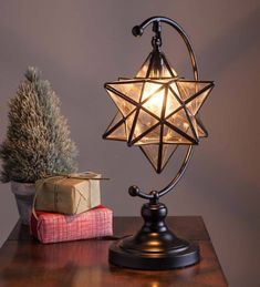 A traditional symbol of Christmas, our handmade Moravian Star Table Lamp adds a warm, peaceful glow wherever you display it. Iridescent, clear glass reflects the light beautifully. Metal frame and stand with black finish. Chandelier bulb not included. Home Interior, Interior And Exterior, Interior Decorating, Interior Design, My New Room, My Room, Bedroom Lamps, Bedroom Decor, Plywood Furniture