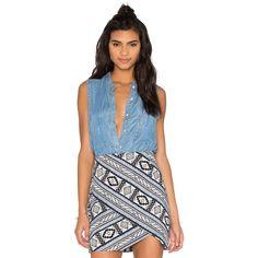 Fifteen Twenty Sleeveless Denim Shirt ($110) ❤ liked on Polyvore featuring tops, fashion tops, sleeve less shirts, blue sleeveless top, shirt tops, denim top and no sleeve shirt