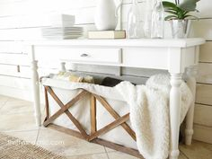 DIY wood and canvas laundry crates. Burlap would be cheap too.