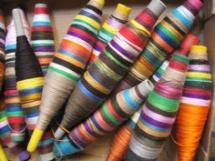 Multicoloured bobbins, weavers' workshop. Photo by Mary Loosemore.