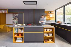 Kitchen units and other fitted cabinets in the quirky property are made from a coloured MDF material called Valchromat