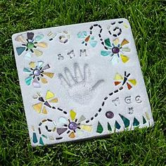 """A handcrafted stepping stone for your garden to preserve memories forever!  Add your baby's handprint or footprint (how cute would that be?)  Use letter stamps to include names or messages like """"I Love You.""""  And add the decorative pieces to create flowers or other beautiful designs."""