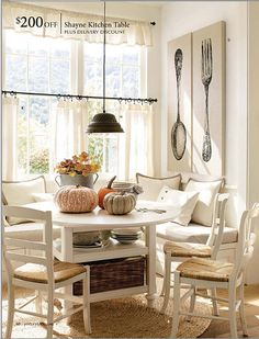 breakfast nook - love the table - love how the dishes are stored there - so cute and practical if you didn't have little ones to worry about