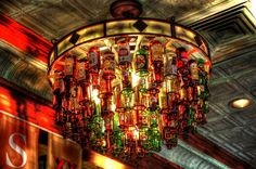 On The Boarder Mexican Grill.   Here is a photo for you beer lovers out there. I am not a drinker and not too  fond of it. One main reason is that liquor triggers my asthma, which results to  me taking our my inhaler and using it. Anyways, I found this very interesting  since it's using real beer bottles to create a beautiful and creative  chandelier. Someone should try this at home =]