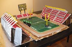 This is Commonwealth Stadium in Edmonton, Alberta, where the Edmonton Eskimos play. The hardest part was doing the lights that stick out from the top of the stadium. I used Popeye candy sticks and those retro yellow dot button candies that come stuck to a piece of paper.