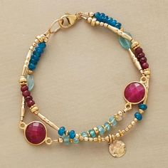 "RUBY BLUES BRACELET Ruby rounds in golden rims are spotlights amid a two-blue mix of apatites, smooth and faceted. Paillettes and a variety of 14kt goldfill beads lend their glow. Lobster clasp. Sundance exclusives handcrafted in USA. Approx. 7-1/2""L."