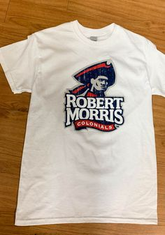Robert Morris Colonials White Primary Logo Distressed Short Sleeve T Shirt - 22785444 Temporary Store, Distressed Shorts, Short Sleeve Tee, Pittsburgh, Logo, Tees, Sleeves, Mens Tops, T Shirt