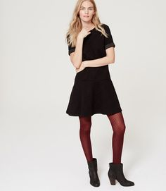 This dress is great. I love how you can pair it with the colored tights and boots. Perfect