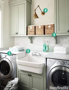 Great farmhouse sink in laundry room. I'd rather my washer and dryer be side by side for ease of laundry transfer, though it does look great this way.