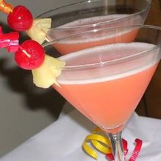 Ingredients    2/3 cup pineapple juice, chilled  1/3 cup vanilla flavored vodka  1 dash grenadine syrup  2 pineapple wedges  2 maraschino cherries    Directions    Pour the pineapple juice, vodka and grenadine into a shaker full of ice. Shake, then strain into two martini glasses. Garnish with a piece of pineapple and a cherry on a skewer.