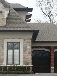 Large crown moulding used on stucco, brick and stone facades on this custom home.