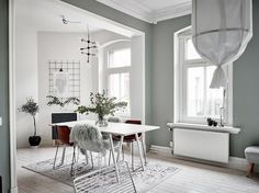 Dining room in green and white in a calm Swedish home