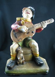 Plaster guitar playing guy given to my banjo playing father by my grandmother. This was given to my dad on his first trip he took to visit my mother's homestead about 60 plus years ago.