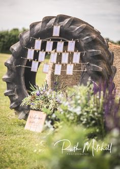 Seating plan made from tractor tyre Country Wedding Photos, Rustic Wedding, Tractor Wedding, Car Themed Wedding, Marquee Wedding, Wedding Venues, Homemade Wedding Decorations, Cute Wedding Ideas, Wedding Pinterest