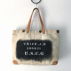 """40's US Coast Guard heavy canvas tote bag. Very thick canvas is here. Marking on Bag """"TRIPP,J.B 508651 U.S.C.G"""" Reinforced corner with 2mm thick leather. Nice vintage condition.  IND_BNP_0426 W51cm H33cm D14cm Handle50cm"""