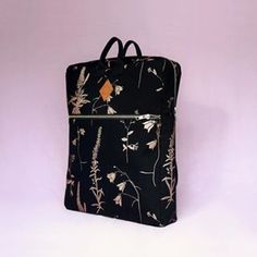 The pattern on this backpack is hand printed in the metallic shade of copper with a slight shimmer of nacre, on a black cotton base. Made in Finland. Black Cotton, Finland, Lunch Box, Metallic, Copper, Shades, Base, Backpacks, Printed