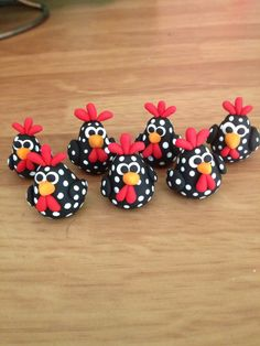 Here are the cutest spotted roosters! This listing is for a set of 2 roosters. ! I can put them on picks for your miniature garden or just left as a sweet little figurine. They are handmade out of polymer clay and are a little less than an inch tall and will vary slightly in shape and