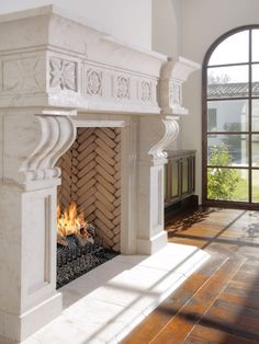carved stone fireplace, herringbone  brickwork