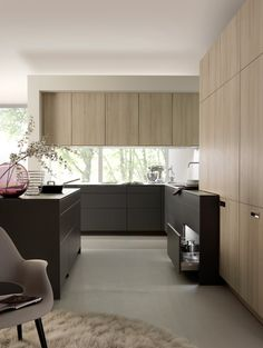 One of the most popular looks is darker colors and cabinetry for the base cabinets, and lighter upper cabinets which help provide a sense of openness.