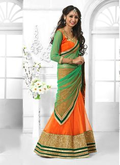 We are to breathe life into your aspirations and to make a mark in the world of style. Be your own style diva with this orange net a line lehenga choli. Beautified with embroidered and patch border wo...