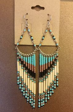 If you are looking to add some flavor your outfit you have no doubt looked into these one of a kind handmade earrings. Featuring turquoise, pearl, and black color seed beads with fired bamboo. These earrings are very light weight and hand at approximatelly 4 inches from the earlobes,