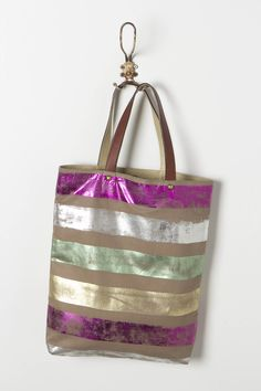 e1cfac3389890 We love the way the metallic foil on Jasper  amp  Jeera s carryall crackles  in time