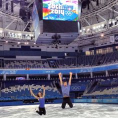 Canadian Pairs Team members Meagan Duhamel and Eric Radford leap for joy during their practice on Olympic Ice in the Ice Berg Skating Palace.