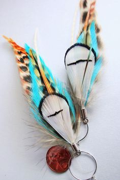 Rooster feathers and Lady Amherst pheasant tippets  5.5 inches    Each pair of earrings is made with with fly fishing feathers and elegant metal