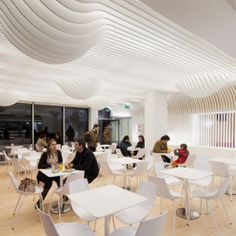 Bakery in Porto  by Paulo Merlini.Paulo Merlini installed the stripy ceiling to fulfil two key functional requirements: reducing glare from the overhead lighting and improving the acoustics inside the bakery.