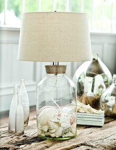 Beach cottage style table lamp with a removable cork top to make filling the round jar base with your beach treasures a breeze! Think sea glass, bit of shells - bring home your vacation memories for display.