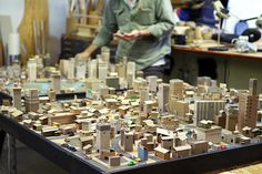 """Paper City by Kiel Johnson  Part of Kiel Johnson's """"Everyone's An Architect"""" installation at TEDActive this year. The project continues to grow throughout the time it's displayed ascollaboratorsstop by to add their personal touch to this paper metropolis. The cities lights are powered by human foot traffic as visitors jump on pressure pads located around the city.    Artists:   Website   [via: The Fox Is Black]    Watch:"""