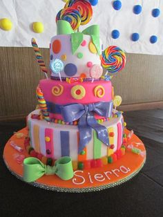 Candy Cake - * Candy theme cake.  Fondant with gum paste bows.
