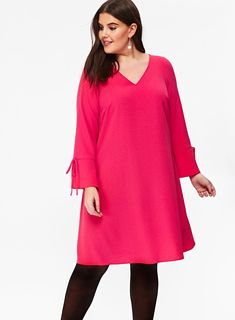 The stylish pink tie sleeve shift dress is a staple for your wardrobe. With a fluted cuff this pink dress is on trend. Wear with tights and flats for a perfect workwear look. | Evans