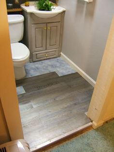 How to Install Vinyl Tiles Over Ceramic Tiles in the Bathroom ...
