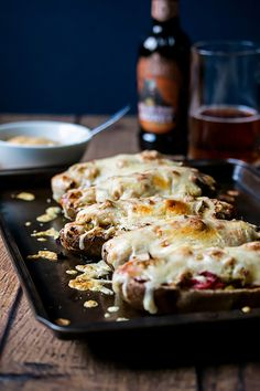 Stuffed potato skins full to the brim of thin sliced smoked meat, sauerkraut, a sweet and spicy sauce and bubbling Swiss cheese.