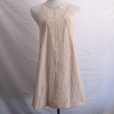 LF Lace Dress LF Beige Crochet Lace Dress. Features sheer tulle neckline and back. New with tags! Prices are negotiable, so please make an offer using the offer button.  NO TRADES LF Dresses