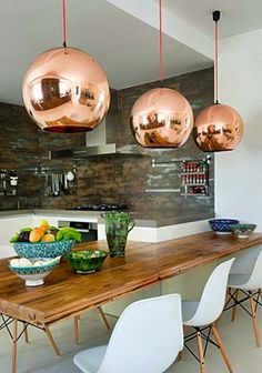 Where the Sidewalk Begins: Dining Table + Copper Hanging Lights. (not so much the table, but I am in love with the copper lights) Copper Hanging Lights, Copper Lighting, Copper Lamps, Pendant Lights, Pendant Lamps, Brass Pendant, Gold Lamps, Copper Ceiling, Hanging Lamps