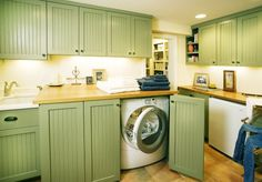 Random idea that could turn into something totally awesome...Open the laundry closet up and make it look like a built-in alcove area. Cabinet doors still cover the washer/dryer, but the rest of the space also adds the the decor of the hallway instead of plain old bifold doors covering the whole thing.