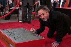 "Tim Burton was honored at Hollywood's Chinese Theatre ahead of the opening of ""Miss Peregrine's Home for Peculiar Children,"" and Mark Oguschewitz was on hand for the star-studded event. Continue reading for all the details and #StayPeculiar"