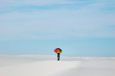 White Sands National Monument, New Mexico  Sam took some super-cute photos of me with the rainbow umbrella.  Be sure to check them out here.