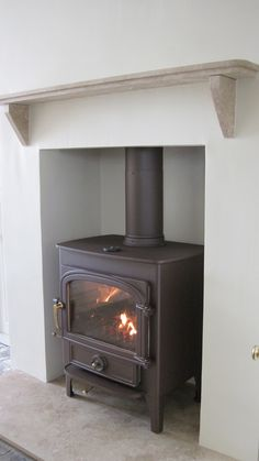 Clearview Vision 500 wood burner in mahogany brown and Turkish travertine hearth and mantel shelf. Good to have it tucked into a hearth. Wood, Front Room, Hearth, Wood Burner, Stove, Travertine Hearth, Front Rooms, Family Room Fireplace, Fireplace