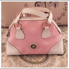"""Dooney & Bourke Domed Satchel,PINK/WHITE NWOT, Dooney & Bourke Domed Spectator Satchel in pink & white signature D&B canvas with white tumbled leather trim, tassels & handles. Gold tone hardware. Zipper closure with one inner zip pocket & an area to hold your cell phone, lip gloss, perfume, etc. there is also a white leather """"dog leash"""" to attach your keys to so you can be on your way quickly! A beautiful addition to your spring/summer wardrobe, the spectator look is a classic that never…"""