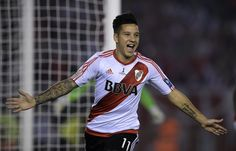 Argentina's River Plate forward Sebastian Driussi celebrates after scoring a…
